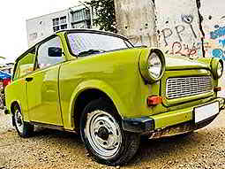 A green trabant parked up