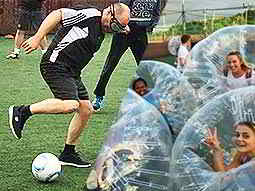 A split image of a man playing goggle football and women posing in inflatable bubbles
