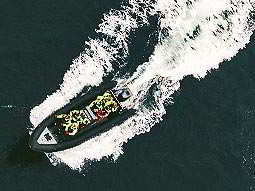 Birds eye view of a speedboat on water