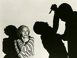 A black and white image of a woman and the shadows of two men fighting
