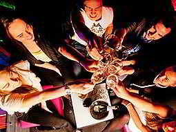 Top-down view of a group of people raising glasses and clinking them together