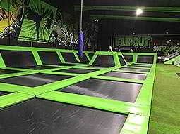 A trampoline zone with Flip Out written in the background