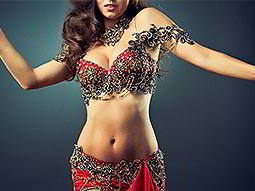 A woman dancing with a Bollywood style bikini on
