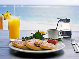 Breakfast on a table with a picturesque view of the sea in the background