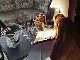 A split image of a bottle of Prosecco in an ice bucket and a girl receiving a make over in a salon