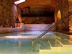 Some indoor baths in Barcelona, with steps leading into the water