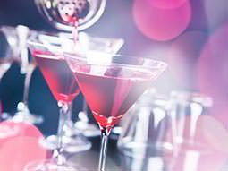 Two red cocktails in martini glasses