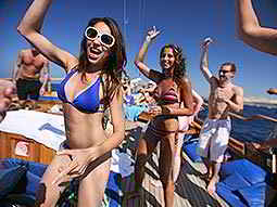 People partying on the outer deck of a boat at sea