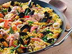 Paella in a black pot