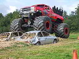 A Monster Truck crushing a car