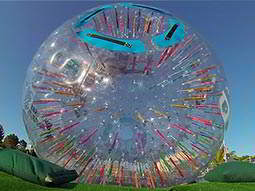 An inflatable zorb outside