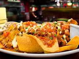 A plate of nachos in a bar