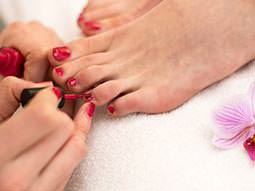 Close up of someone paiting a persons toenails