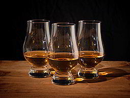 Three whiskey glasses on a table