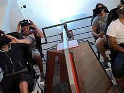 Four people sat down and putting on 3D glasses
