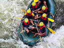 Bird's eye view of people in a raft in a river