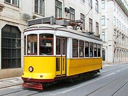 A tram travelling through a narrow street