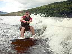 A man cable skiing on water