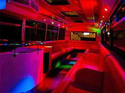 Interiors of the party bus lit up red and blue