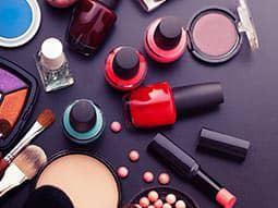 Make up and nail varnish on a counter