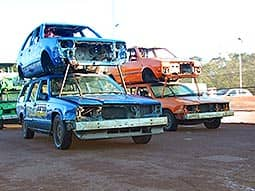 Two cars piled on top of others