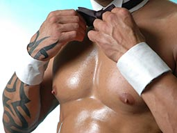 A close up of a topless waiter