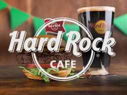 A burger and a pint of Guinness in a Hard Rock glass