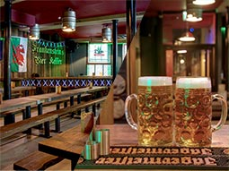 A split image of the interiors of Frankenstein Bierkeller and two steins on a table