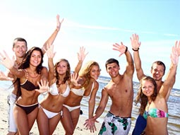 A group of people posing for a picture in swimwear