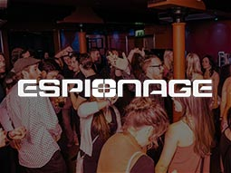 The Espionage logo over an image of people dancing in a club
