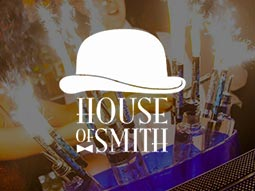 House of Smith logo over bottles set alight with sparklers