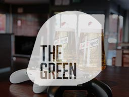 The Green logo overlapping two pints of San Miguel on the table