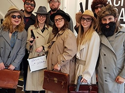 People dressed up as detectives in the Escape Room, Southampton
