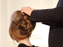 A hairdresser styling a girl's hair