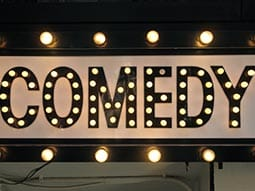 Close up of the word comedy lighten up