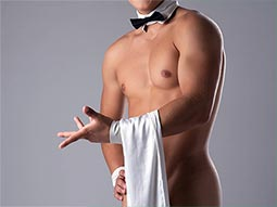 A naked man wearing a bow tie and a piece of cloth draped from his arm