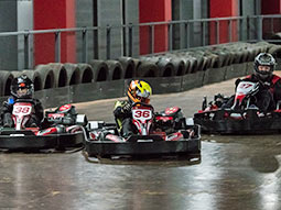Three people racing in go-karts