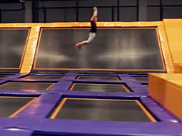 A person jumping on a big trampoline