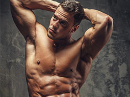A topless man posing