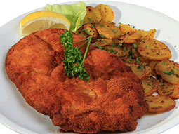 Schnitzel and some potatoes on a plate