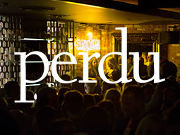 A group of people inside Perdu nightclub, with a logo of Perdu overlapping