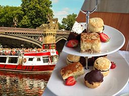 Split image of a red and white river cruise in the water and a two tier cake stand with sandwiches and cakes and scones