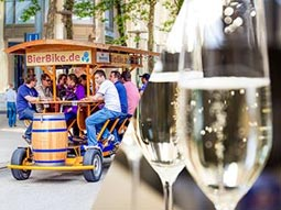 A split image of a beer bike and some glasses of bubbly