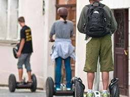 Three people riding on segways