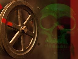 A wheel on a safe with a faded skull in the background