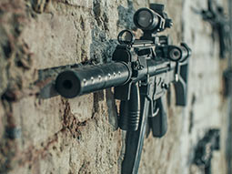 A gun mounted on a wall