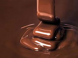 Close up of melted chocolate dripping