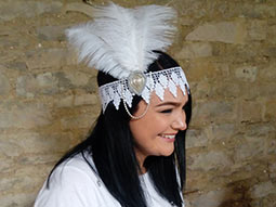 A girl wearing a white 1920s Flapper Headband