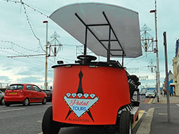 A red pedal bus, parked up outside