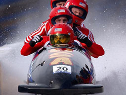 Four people in a Bobsleigh
